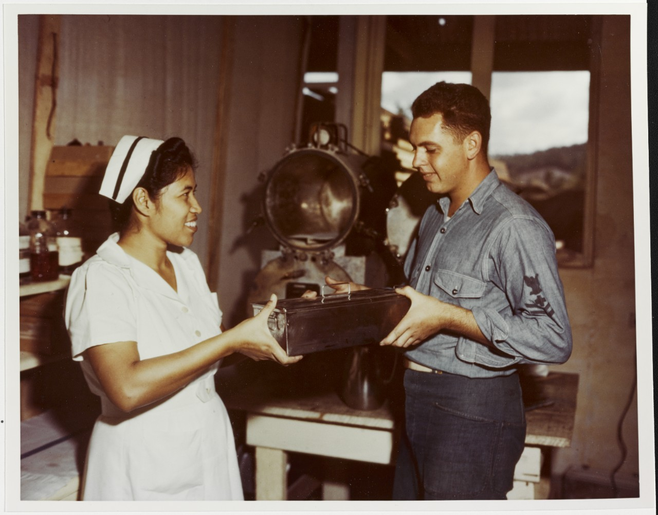 U.S. Navy Hospital Corpsman assists a local nurse in Guam, 1944-1945