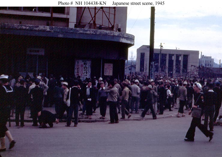 Photo #: NH 104438-KN U.S. Navy Sailors and local residents on a Japanese street
