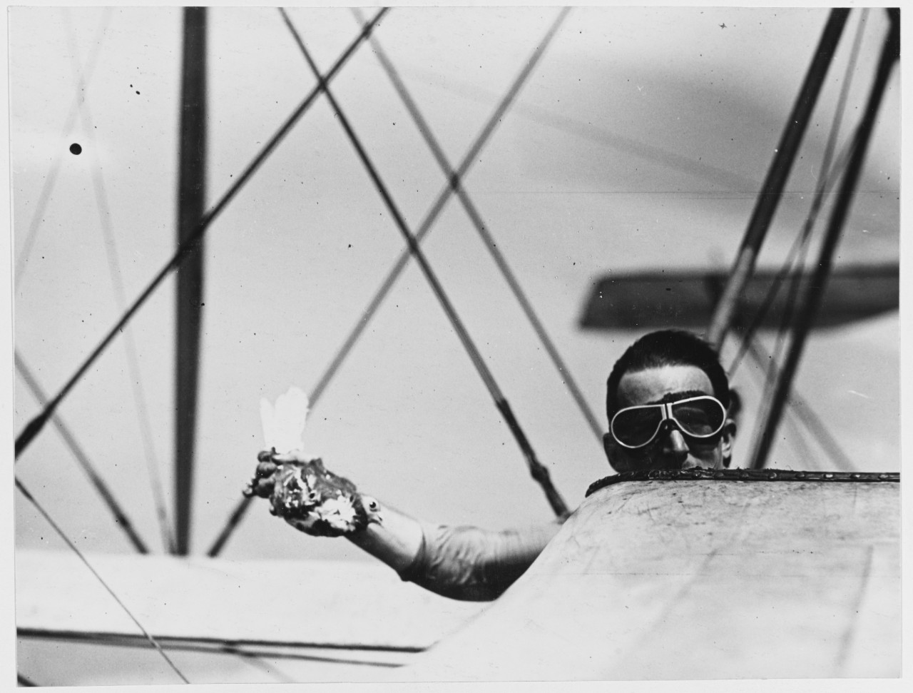 Letting carrier pigeon free from airplane, U.S. Naval Air Station, Anacostia, Washington, D.C.