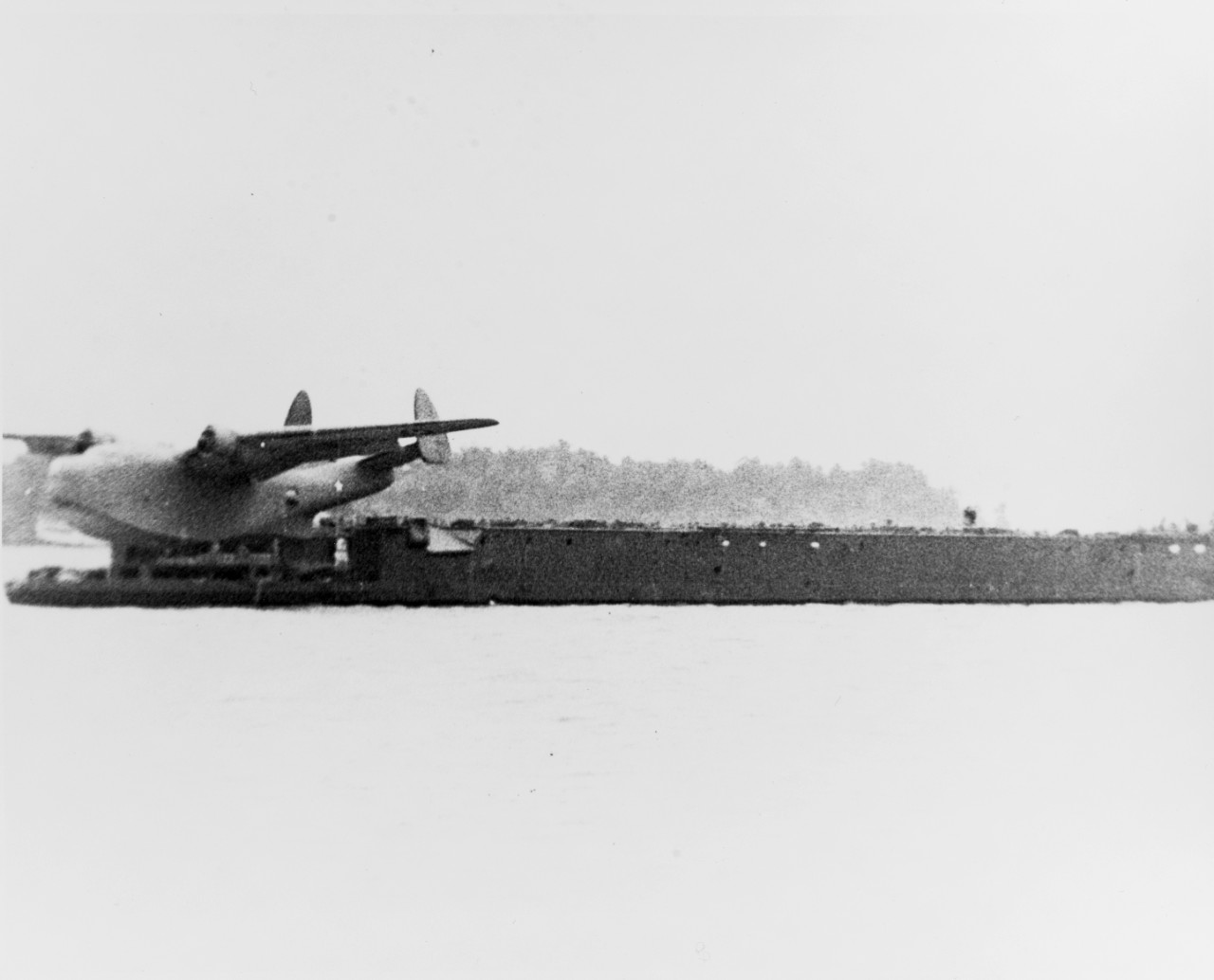 USS AVC-1 on 2 June 1942 with the Martin XPBM-2 patrol bomber at release point from the launching car of the XH-III catapult. This aircraft, Bu# 1247, was a PBM-1 Mariner modified for long-range operations with additional fuel tanks and a reinforced airframe to permit catapult launching. Only the prototype was built, and after catapult trials it served as a static test article at Philadelphia until stricken in June 1944.