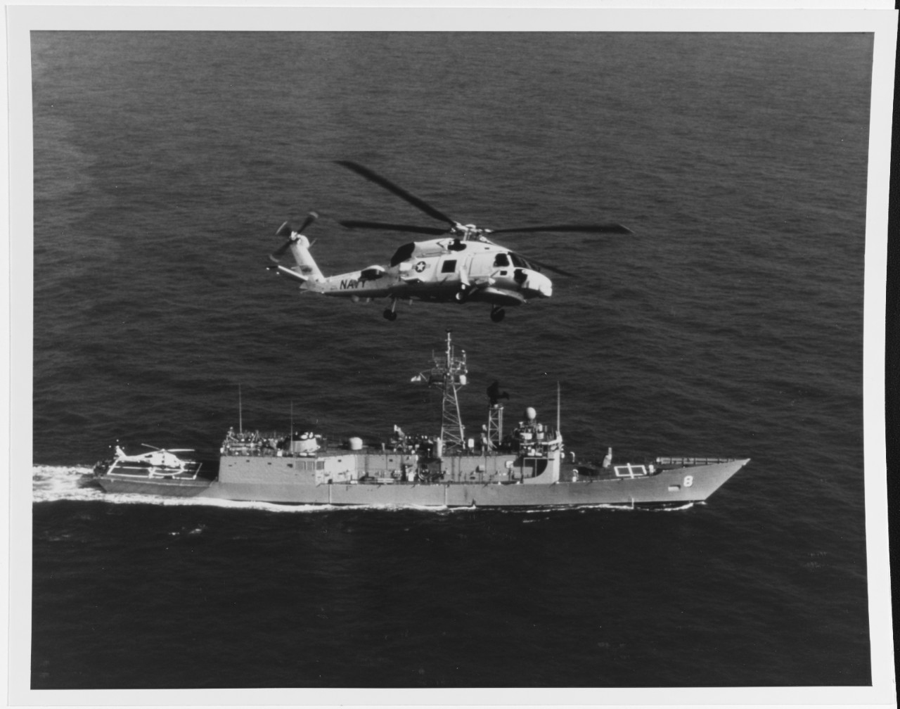 "SIKORSKY SH-60B ""SEAHAWK"" Helicopter in flight over USS MCINERNY (FFG-8), in March 1981"