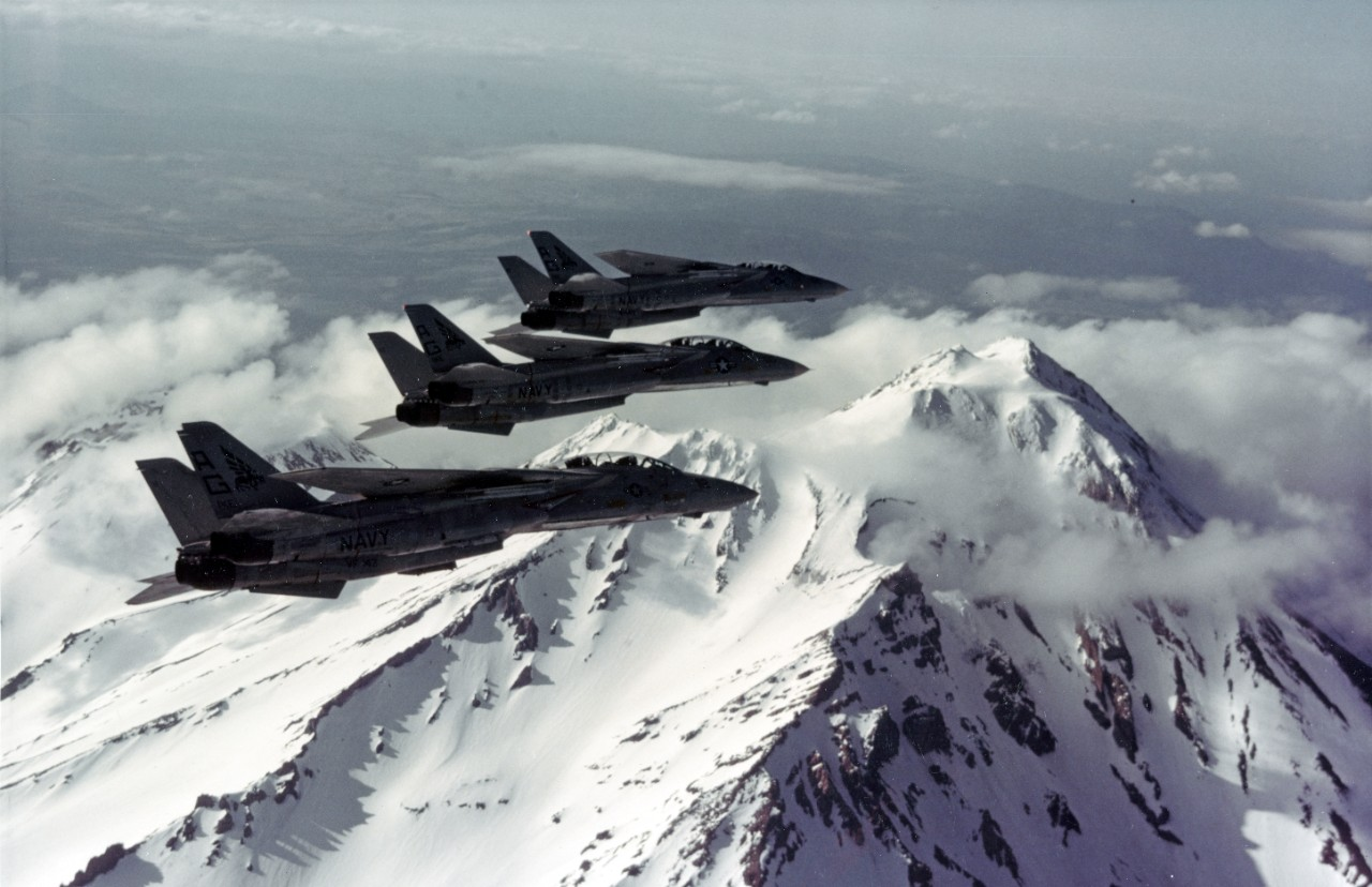"Three F-14A ""TOMCAT"" Fighters, of VF-143, in flight over Mount Shasta, California, in May 1981"