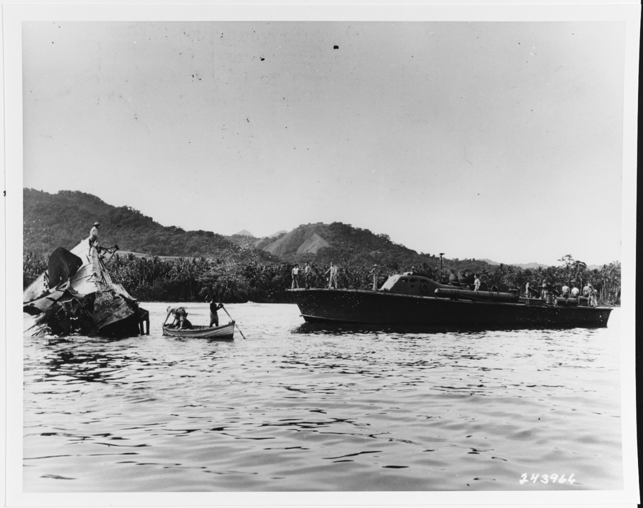 I-1 (Japanese SS, 1924) is examined by Army Intelligence personnel as USS PT-65 stands by, February 11, 1943