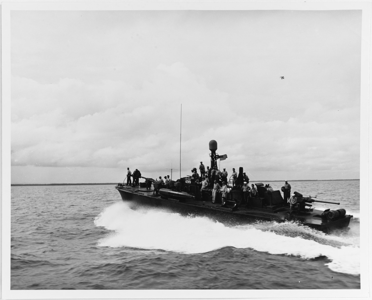 USS PT-490 with General Douglas MacArthur aboard (visible amidships), carrying him and his staff from Negros Island to Iloilo, Panay, in 1945