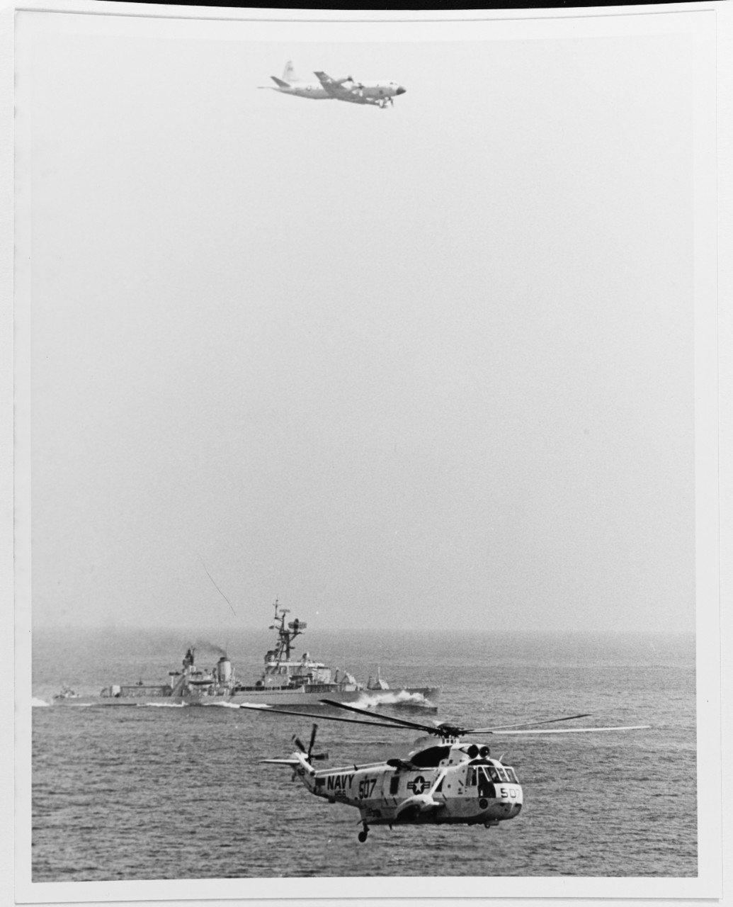 A P-3 Orion Anti-Submarine Warfare Plane, USS BUCK (DD-761), and a SH-3 Sea King Anti-Submarine Warfare Helicopter