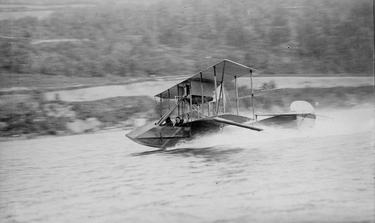 Curtiss flying boat taxiing on water