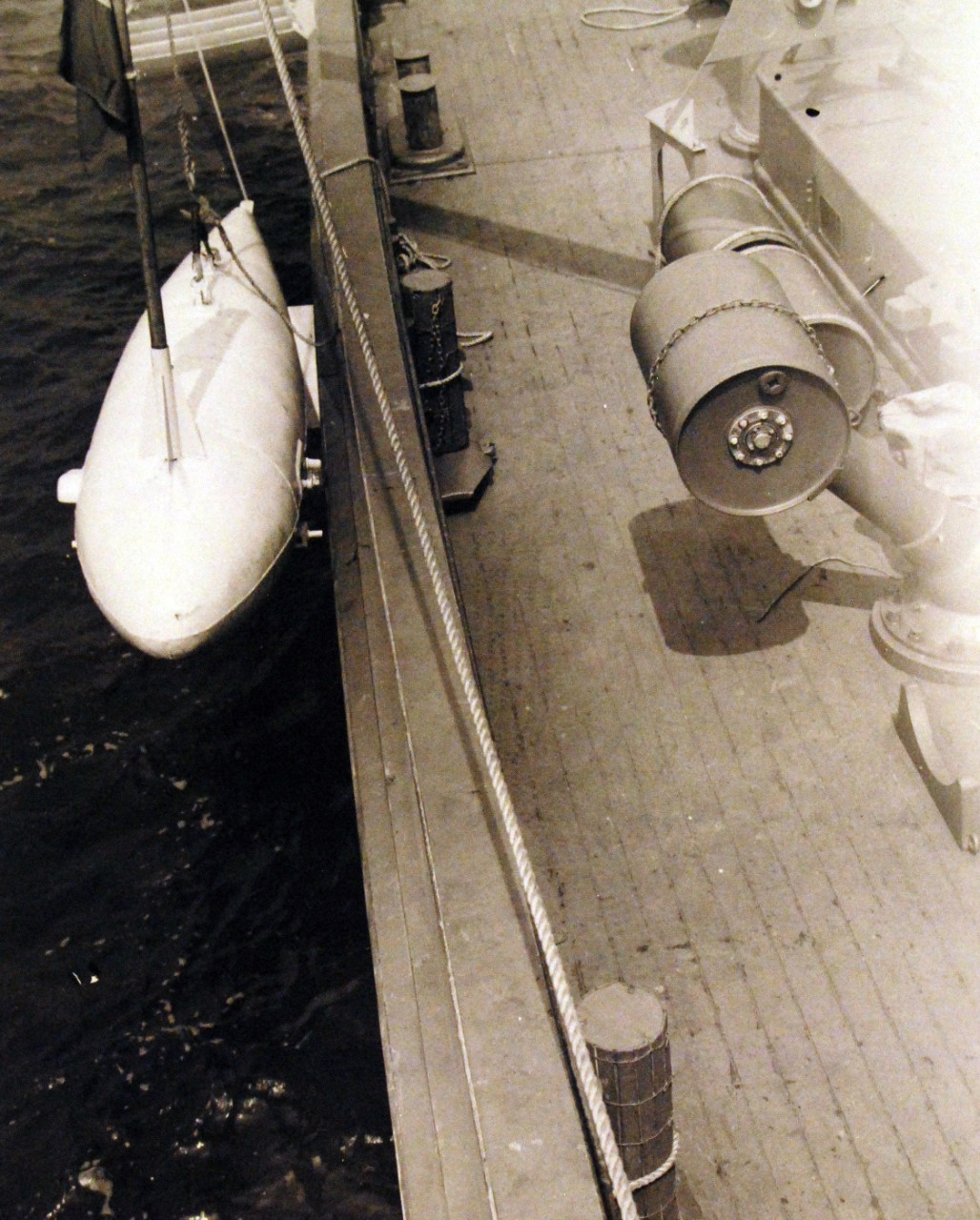 "80-G-6606:   Battle of the Atlantic: Weapons: K-Gun.   Navy Mine School, Yorktown, Virginia.   Work on mine sweeper USS YMS-20 and USS YMS-38.   ""0"" type float at the rail ready for streaming.    Photographed circa May 1942.  Official U.S. Navy Photograph, now in the collections of the National Archives.   (2016/10/11)."