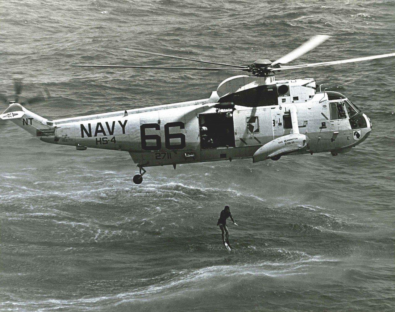 <p>A helicopter drops a UDT swimmer into the water during Apollo 11 recovery practice&nbsp;exercises.&nbsp;</p>