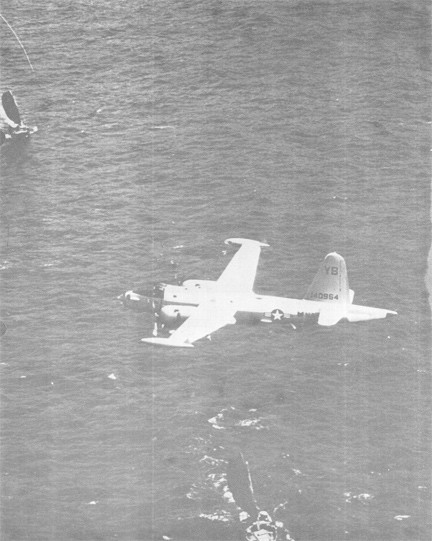 Image of An SP2H NEPTUNE Flies Low over Two Vietnamese Junks off the Coast of Vietnam