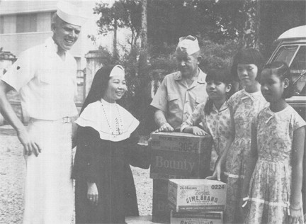 Image of Coast Guard Personnel Distribute Civic Action Material at Saigon School for Blind Girls
