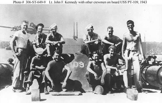 Lt. John F. Kenndey with other crewmen onboard USS PT-109, 1943. Naval History and Heritage Command, Photographic Section, Photo# 306-ST-646-9.