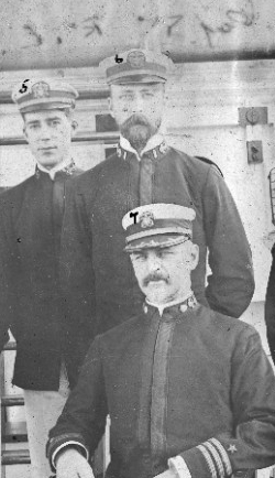 Lt. Price (standing center); Officers of USS Don Juan de Austria, Photograph taken while at Canton, China, circa September 1900. Officers listed are numbered as follows: 1. Lieutenant Junior Grade John D. Barber, Asst. Paymaster, USN; 2. Naval Cadet Allen Buchanan, USN; 3. Lieutenant John L. Purcell, USN; 4. Ensign William L. Littlefield, USN; 5. Naval Cadet Ralph E. Pope, USN; 6. Lieutenant Henry B. Price, USN; 7. Commander Thomas C. McLean, USN, CO; 8. Lieutenant Harold A. Haas, Asst. Surgeon, USN; and 9. Lieutenant Armistead Rust, USN Courtesy of the Naval Historical Foundation, Washington, D.C. U.S. Naval History and Heritage Command Photograph, NH 104885.