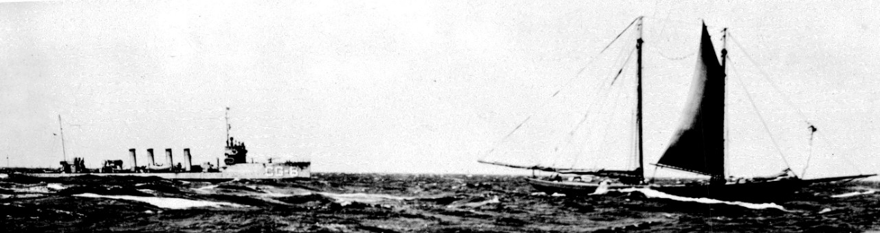 Ammen, designated CG-8 during her service with the U.S. Coast Guard, picketing an unknown rumrunner, 28 April 1926. (U.S. Coast Guard Historian's Office Photograph No. 42826, 28 April 1926)