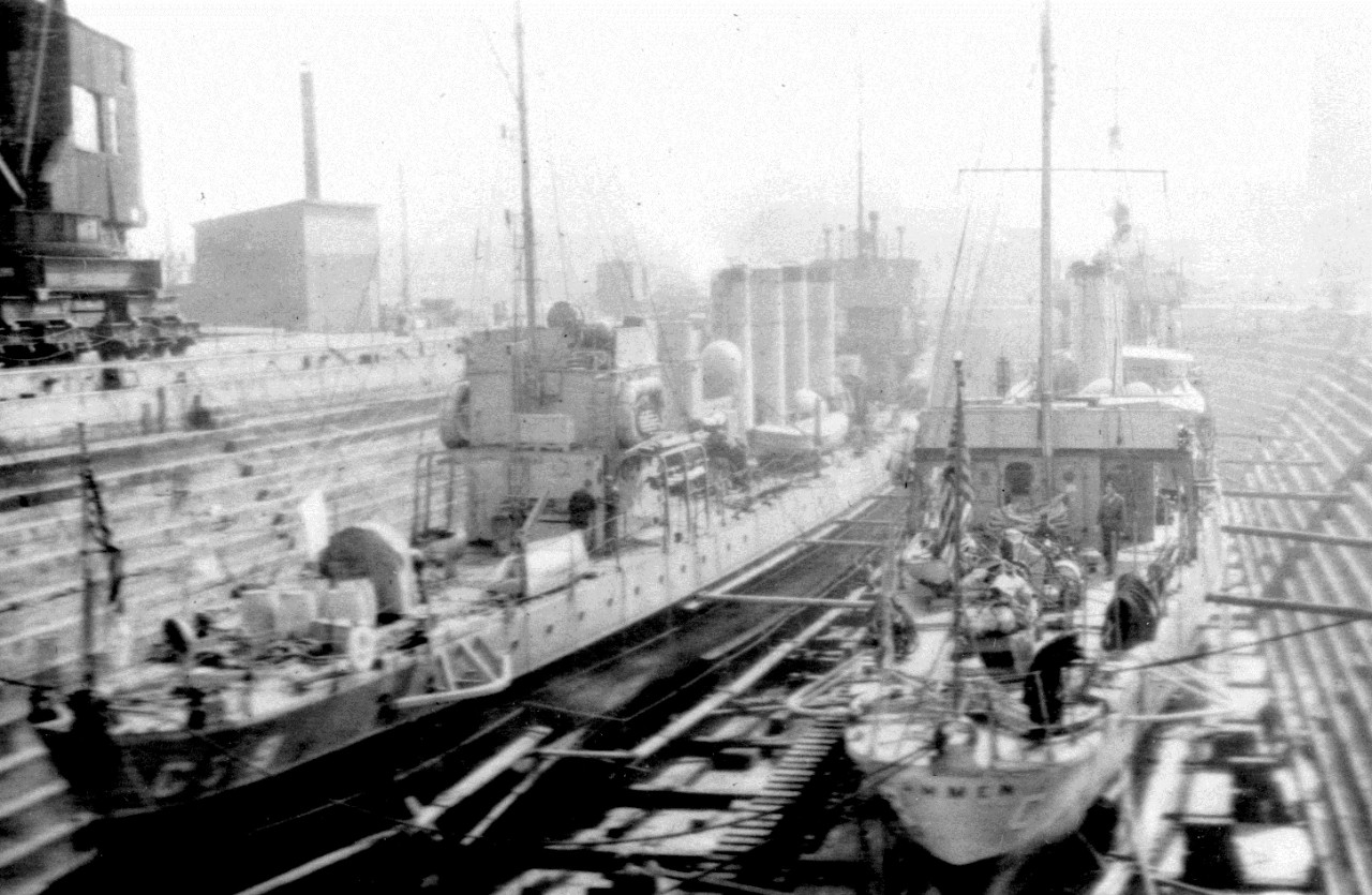 Ammen in dry dock, with another Coast Guard destroyer at left (unidentified). (U.S. Coast Guard Historian's Office Photograph)
