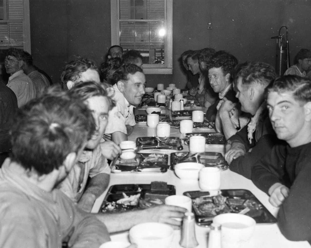 Empire Thrush's sailors sample U.S. Navy chow at the Receiving Station, NOB Norfolk, 15 April 1942 (U.S. Navy Photograph 80-CF-105-4A-2, National Archives and Records Administration, Still Pictures Branch, College Park, Md.)