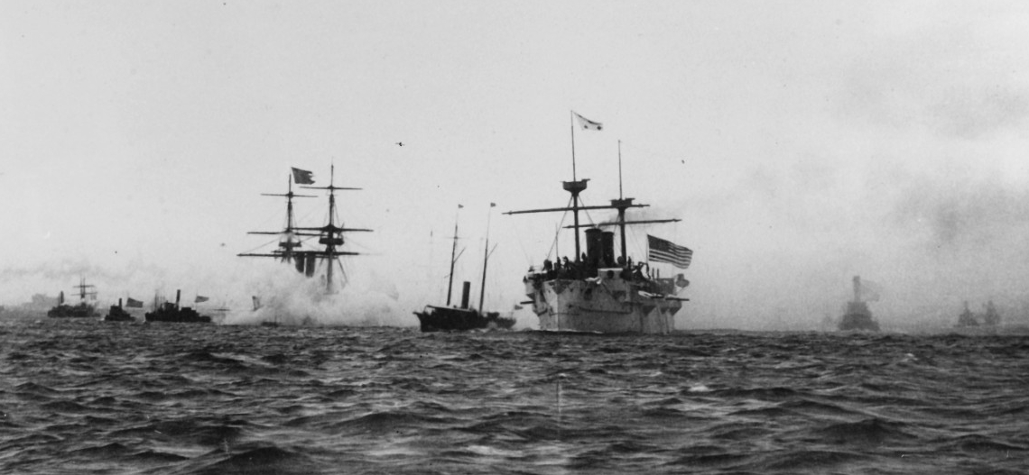Baltimore leaving New York Harbor on 23 August 1890, en route to return the remains of John Ericsson to Sweden. Boston is in the left center, flying the Swedish ensign from her mast peak. (Naval History and Heritage Command Photograph NH 69176)