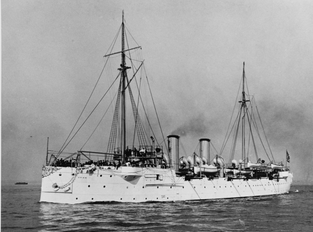 Baltimore underway in New York Harbor, circa 1903. The Statue of Liberty is dimly visible in the right distance. Courtesy of the Naval Historical Foundation, 1975. (Naval History and Heritage Command Photograph NH 83962)