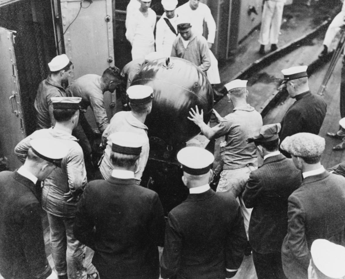 Mine handling operations on board Baltimore, 1920. Note what appears to be a mine elevator at left. Donation of Cmdr. Christopher Noble, USN (Retired), February 1967. (Naval History and Heritage Command Photograph NH 56330)