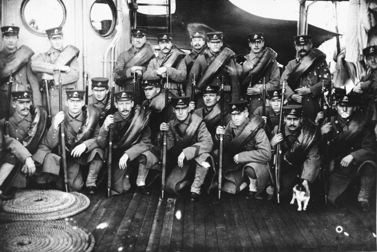 Baltimore's Marine Guard in heavy marching order, during her Asiatic Fleet deployment, circa 1904-1906. They were equipped for winter expeditionary party duty, with horseshoe rolls containing their blankets rolled in rubber ponchos. They are armed with Krag-Jorgenson rifles (M1898) and bayonets, and wear woven double loop cartridge belts. Courtesy of the Naval Historical Foundation. Collection of Capt. Nathan Sargent. (Naval History and Heritage Command Photograph NH 95652)