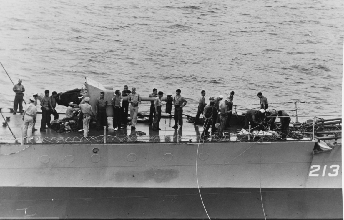 Barker lays alongside Core to transfer the prisoners, most of whom muster near the forward 4-inch gun, 24 August 1943. Note the cleared railings and the blanked off portholes. (Unattributed U.S. Navy Photograph 80-G-269039, National Archives and Records Administration, Still Pictures Branch, College Park, Md.)