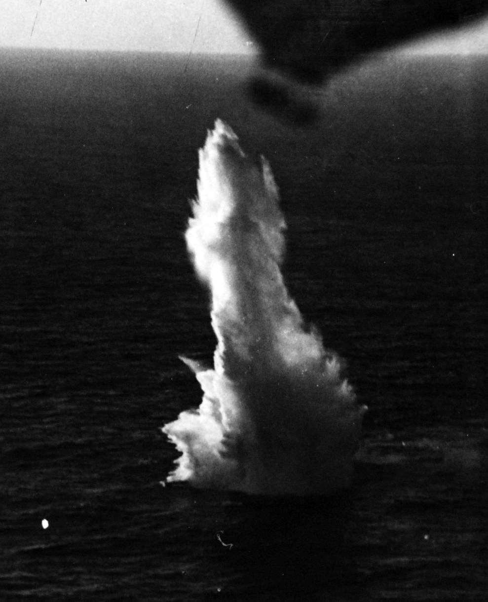 One of the Avenger's bombs explodes during the battle, 24 August 1943. U-185's bow protrudes from the bottom of the explosion in this photograph snapped by the plane. (Unattributed U.S. Navy Photograph 80-G-77195, National Archives and Records Administration, Still Pictures Branch, College Park, Md.)