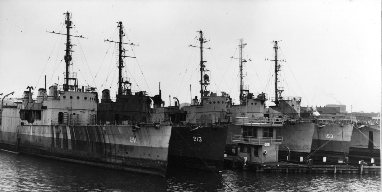 Five sister ships await disposal at Cape May, N.J., 29 October 1945. From left to right they are: Alden (DD-211), Barker, unknown, Bernadou (DD-153), and unknown. The ship berthed next to Barker sports some victory markings on her upper bridge. (Unattributed U.S. Navy Photograph 80-G-446820, National Archives and Records Administration, Still Pictures Branch, College Park, Md.)