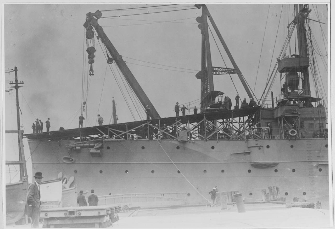 Sailors prepare Eugene B. Ely and his Curtiss Model D Pusher airplane to launch from the deck of Birmingham in Hampton Roads, 14 November 1910. The ship will shortly stand down the channel for the momentous flight. (U.S. Navy Photograph 902872, National Archives and Records Administration, Still Pictures Branch, College Park, Md.)