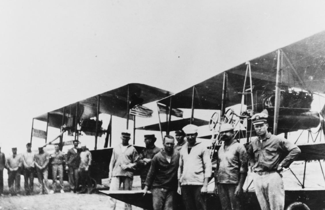 Some of the men at the aviation camp at Vera Cruz take a few moments for pictures; Lt. (j.g.) Patrick N. L. Bellinger stands defiantly (right), and the Stars and Stripes identify aircraft. The Curtiss AH pusher behind Bellinger may be the first U.S. naval plane hit by enemy fire. (U.S. Navy Photograph 80-G-391984, National Archives and Records Administration, Still Pictures Branch, College Park, Md.)