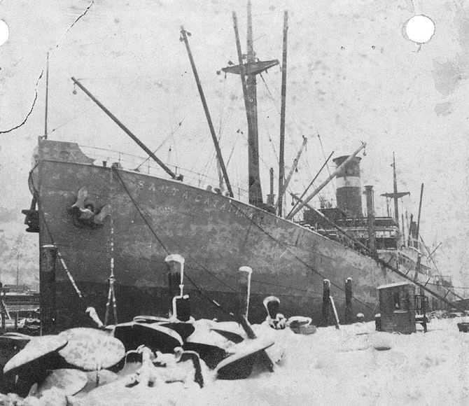 The freighter Santa Catalina in port on a snowy day. (Naval History and Heritage Command Photograph NH 99386)