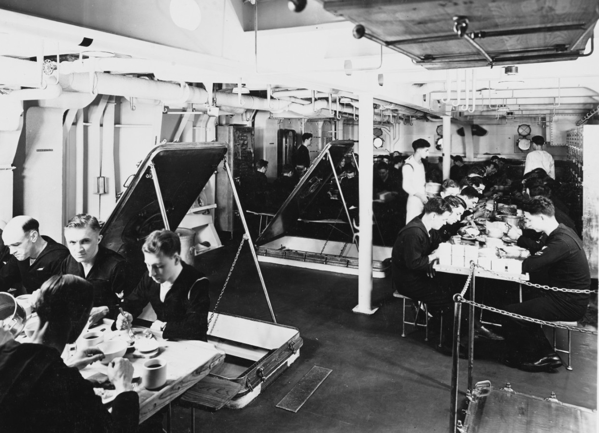 Sailors eat a meal on the mess decks, 18 January 1938. (Naval History and Heritage Command Photograph NH 56618)