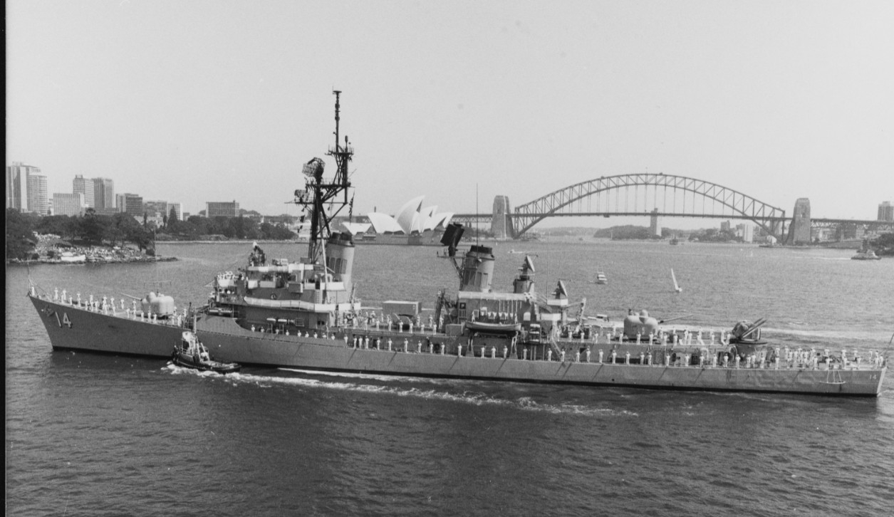 Buchanan visits Sydney, Australia, 1985. The Sydney Opera House and Sydney Harbour Bridge rise in the background. (Naval History and Heritage Command Photograph NH 106737)