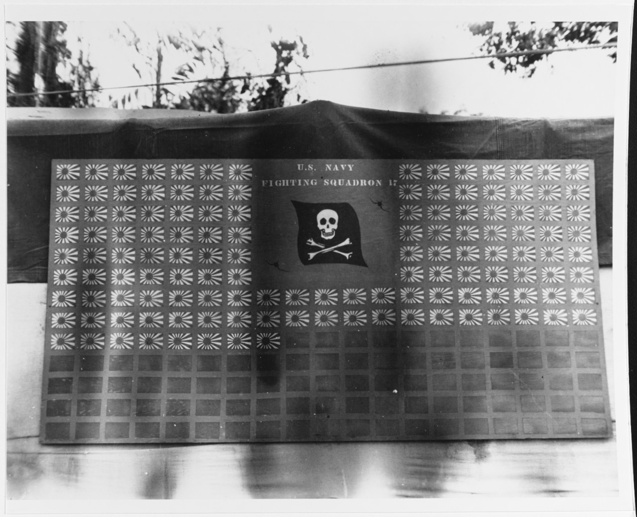 "The men of VF-17 keep a scoreboard on Bougainville of their ""kills,"" which in this photo shows their claim of splashing 130 enemy planes, circa February 1944. The fighter pilots score all of these victories over the Solomon Islands, in November 1943 and January–February 1944. (U.S. Navy Photograph 80-G-255886, National Archives and Records Administration, Still Pictures Division, College Park, Md.)"