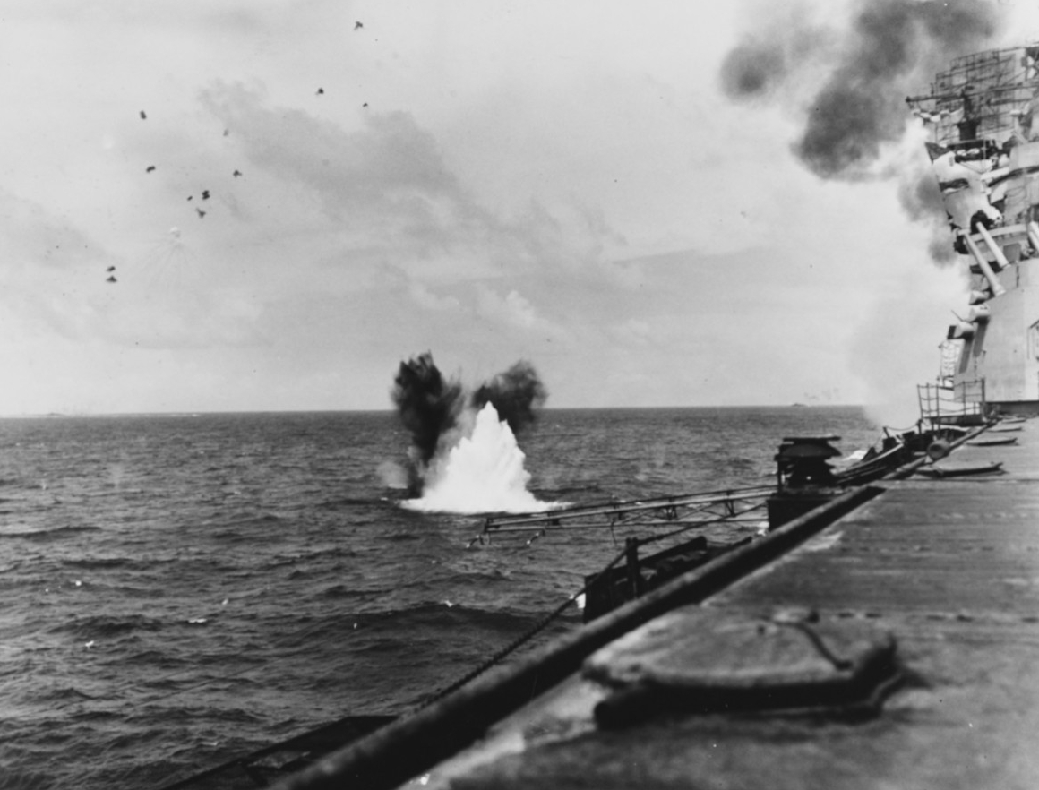 A bomb from a Japanese plane explodes close aboard Bunker Hill in the opening phases of the battle of the Philippine Sea, 19 June 1944. (Naval History and Heritage Command Photograph NH 74281)