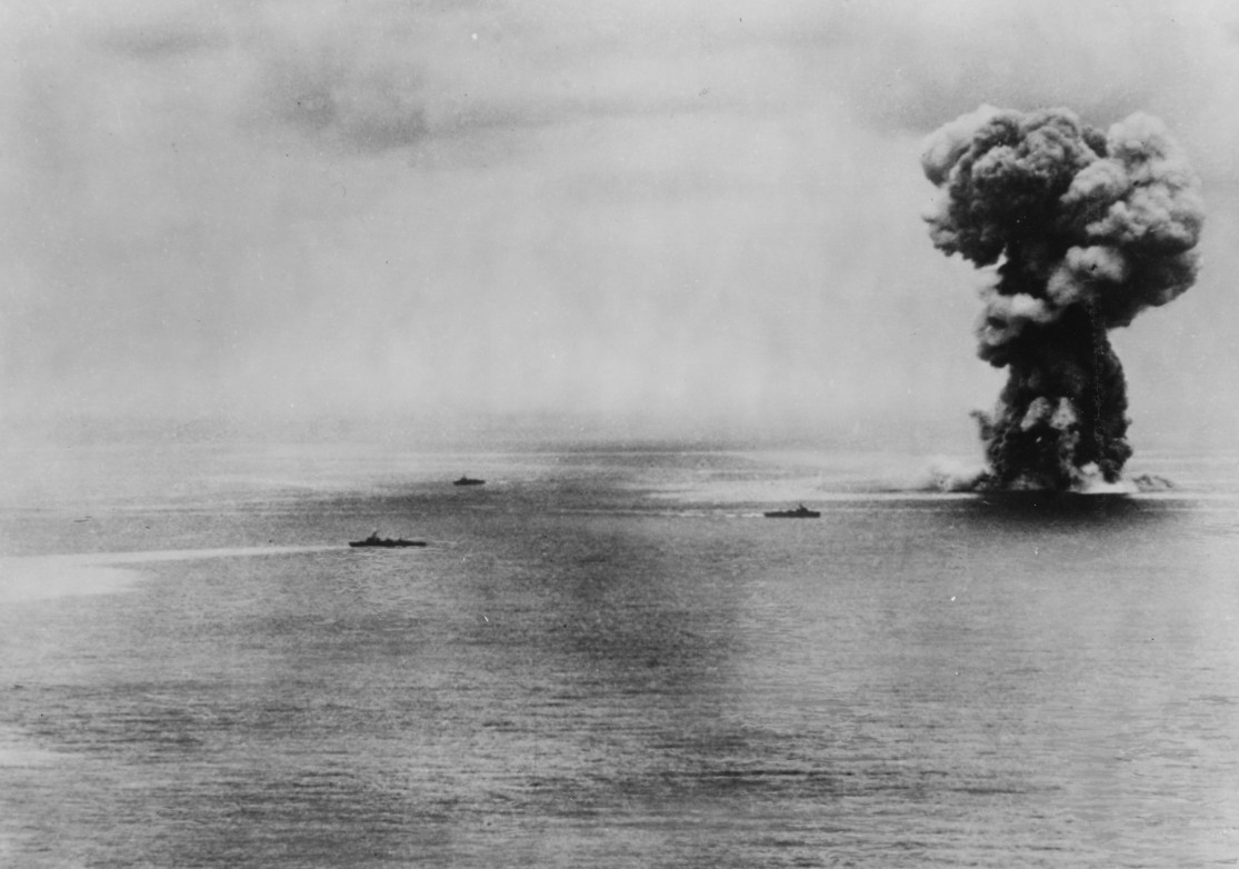 Aircraft from Bunker Hill's air group help sink Japanese battleship Yamato (right) as she attacks Allied ships off Okinawa during Operation Ten-Go, 7 April 1945. A catastrophic explosion rocks the ship as she sinks, most likely from the detonation of 18.1-inch shells stored in one of the magazines. (U.S. Navy Photograph 80-G-413914, National Archives and Records Administration, Still Pictures Division, College Park, Md.)