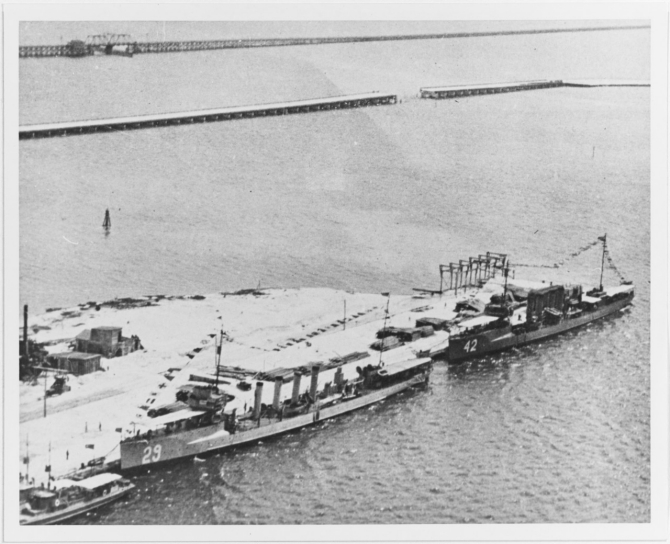 Burrows and Jenkins (Destroyer No. 42) in port, dressed with flags, circa 1919. Courtesy of the National Museum of the Marine Corps. (Naval History and Heritage Command Photograph NH 103739)