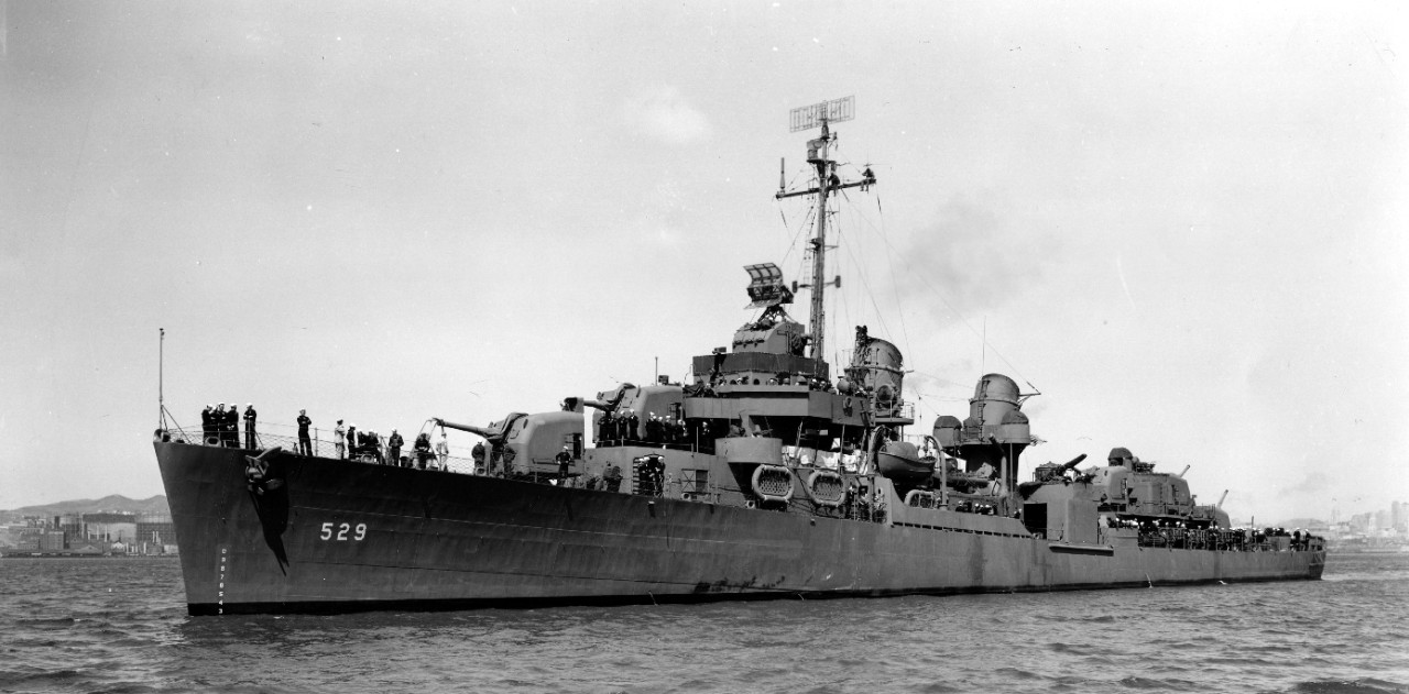 Five days after commissioning, 15 May 1943, Bush stands out in Measure 21, Navy Blue, in San Francisco Bay. Note workmen perched aloft, working on antennae. (U.S. Navy Bureau of Ships Photograph BS-45135, National Archives and Records Administration, Still Pictures Division, College Park, Md.)