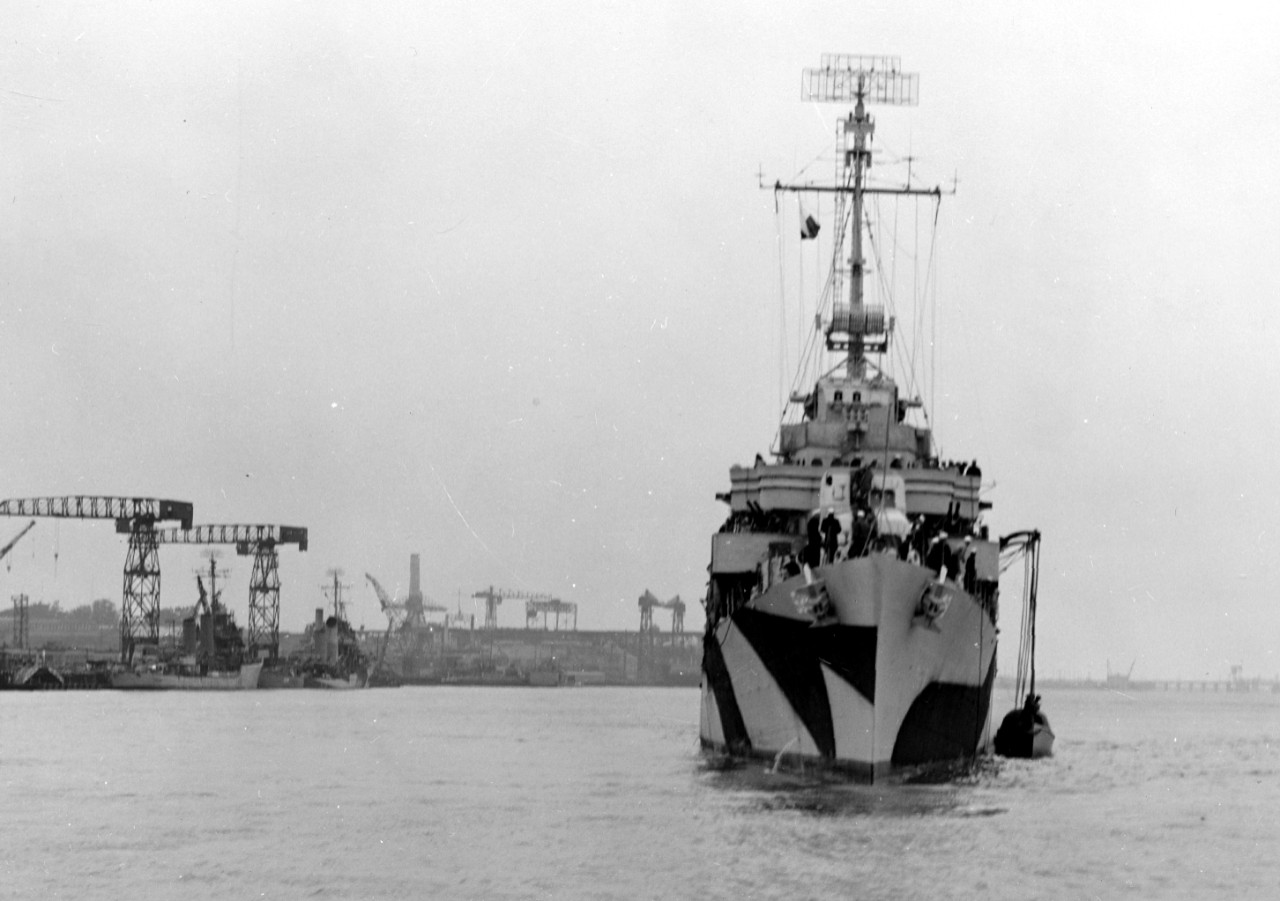 Bow-on view of Bush, 11 June 1944, as she appears to be recovering her gig, while ships can be seen along the waterfront of the Mare Island Navy Yard in various stages of repairs and alterations in the left background. (U.S. Navy Bureau of Ships Photograph BS-67649, National Archives and Records Administration, Still Pictures Division, College Park, Md.)