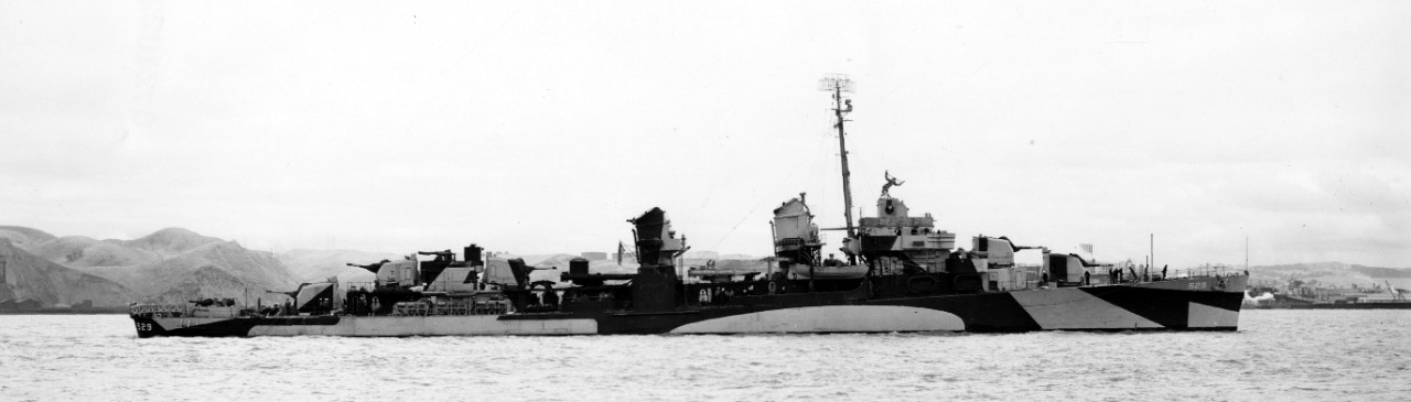 Underway near Mare Island, Bush, painted in Ocean Gray (5-O) and Black, stands up the channel, 11 June 1944. (U.S. Navy Bureau of Ships Photograph BS-67645, National Archives and Records Administration, Still Pictures Division, College Park, Md.)