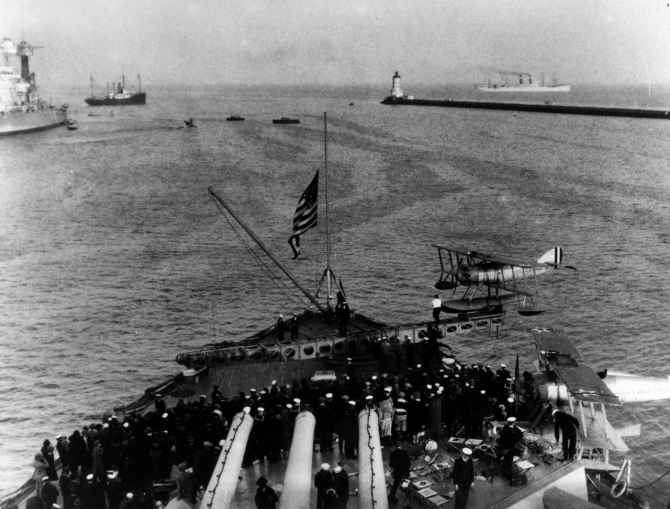 Sailors gather on the fantail to watch the ship launch a Vought UO-1 or FU-1 during Navy Day festivities off Los Angeles, Calif., in the late 1920s. Note the ship's colors at half-mast to honor fallen veterans. (Courtesy of the San Francisco Maritime Museum) (Naval History and Heritage Command Photograph NH 68847)