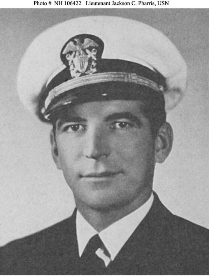 "A halftone reproduction of a photograph of Gunner Jackson C. Pharris, who receives the Medal of Honor for his extraordinary conduct on board on 7 December 1941. The award later disappears after Pharris died on 17 October 1966, however, and his daughter stores the medal in a safe deposit box but then unexpectedly passes away. As the medal is not covered in her will, it becomes the property of the State of California. New legislation allows the state to contact the family to reunite them with the medal, and on 2 October 2007, Vice Adm. Terrance T. Etnyre, Commander Naval Surface Forces, oversees a ceremony at his headquarters in San Diego to return the medal to Pharris' family. ""It is my distinct honor to remember a surface force hero and to reunite a family with a lost family treasure,"" Etnyre observed. ""On behalf of my family,"" Lt. Col. Jackson Pharris II, USMC (Ret.), the Gunner's son, said, ""I would like to thank you very much for returning it to us…I would like to accept it on behalf of those who have served in the past and those who are serving today."" (Unattributed U.S. Navy Photograph NH 106422, Photographic Section, Naval History and Heritage Command)"
