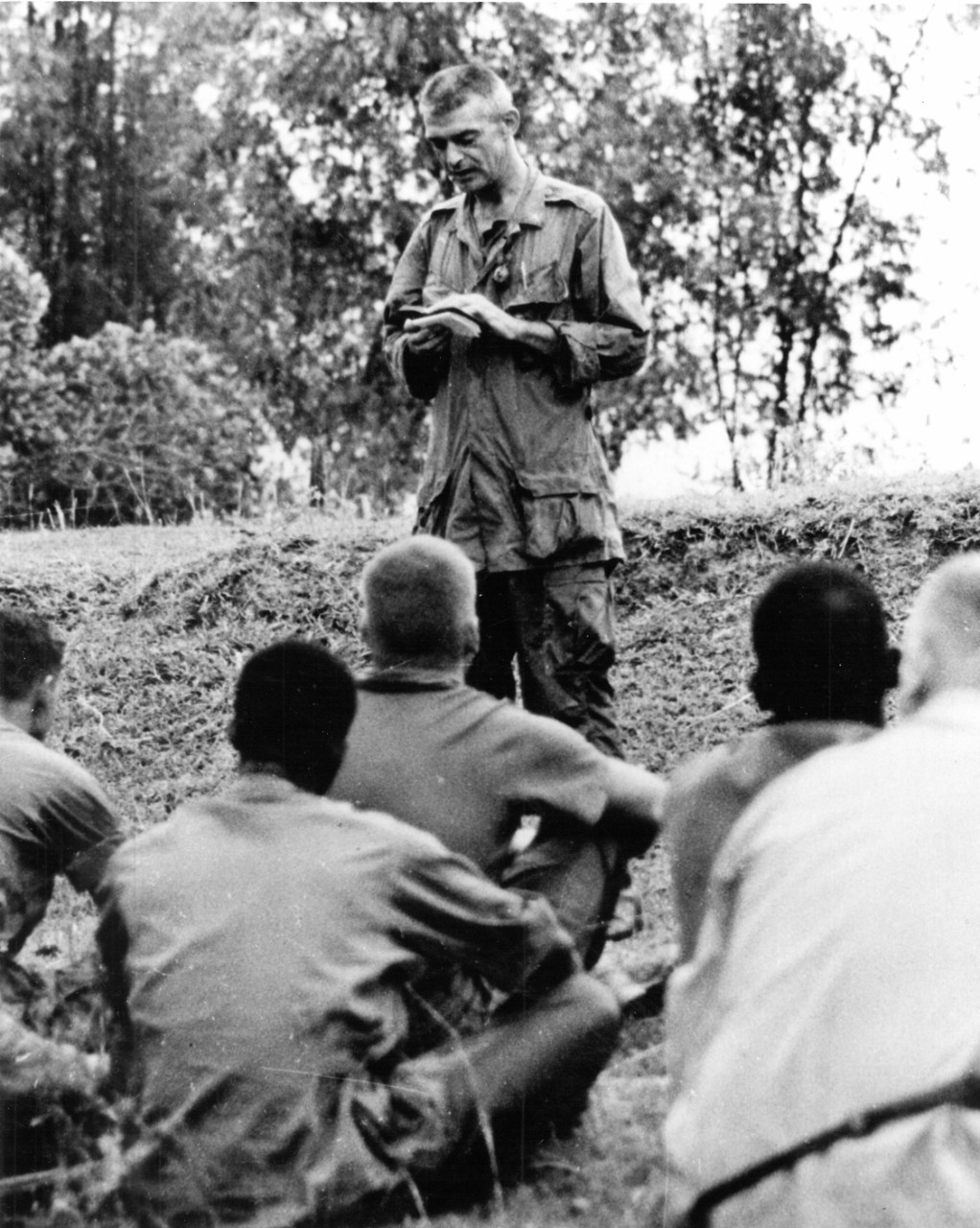 Father Vincent Capodanno ministers to the marines under his care while serving in Vietnam (Capodanno (DE-1093), Ship's History, Naval History and Heritage Command)