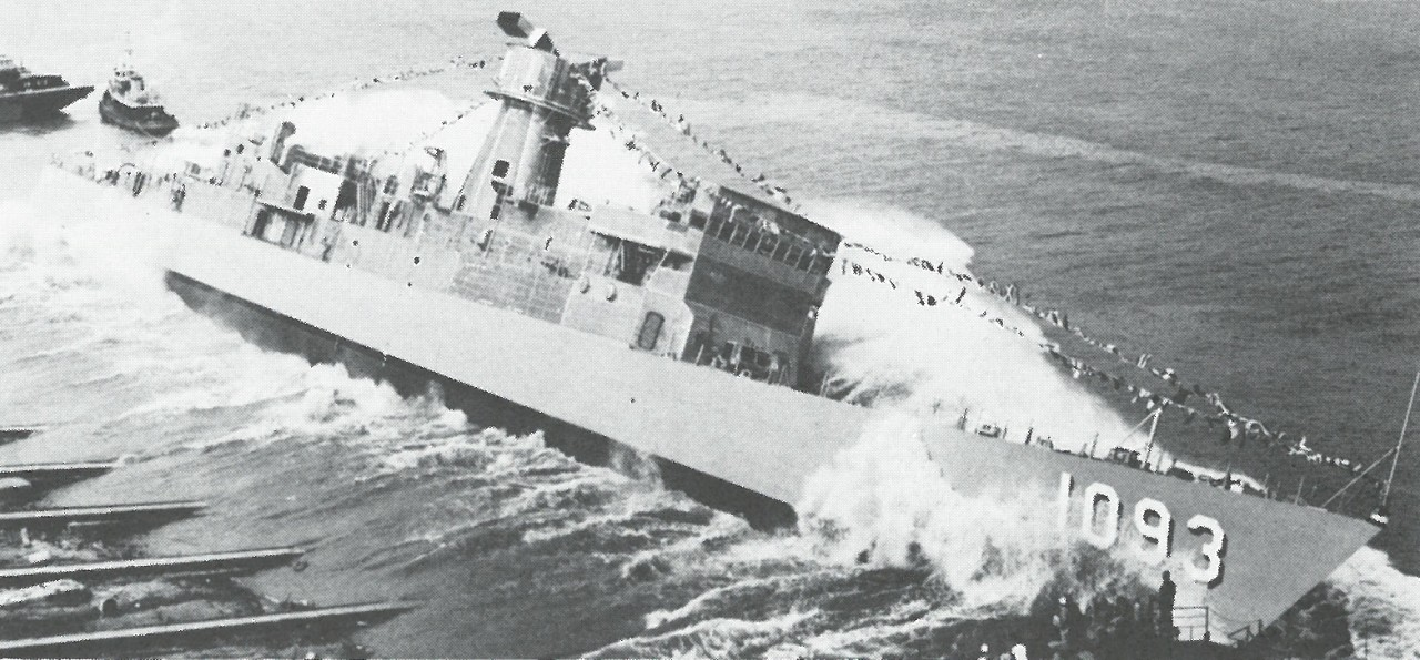 Capodanno is side-launched into the Mississippi River. (Capodanno (DE-1093), Ship's History, Naval History and Heritage Command)