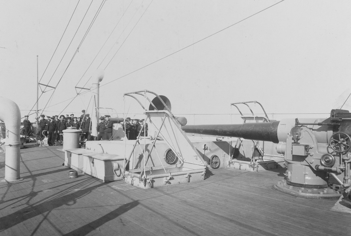 A view of Charleston on the forecastle looking forward, 17 November 1905. Note the 6-inch gun, wooden sea chests, open hatches, and ventilators. (Naval History and Heritage Command Photograph NH 78681)