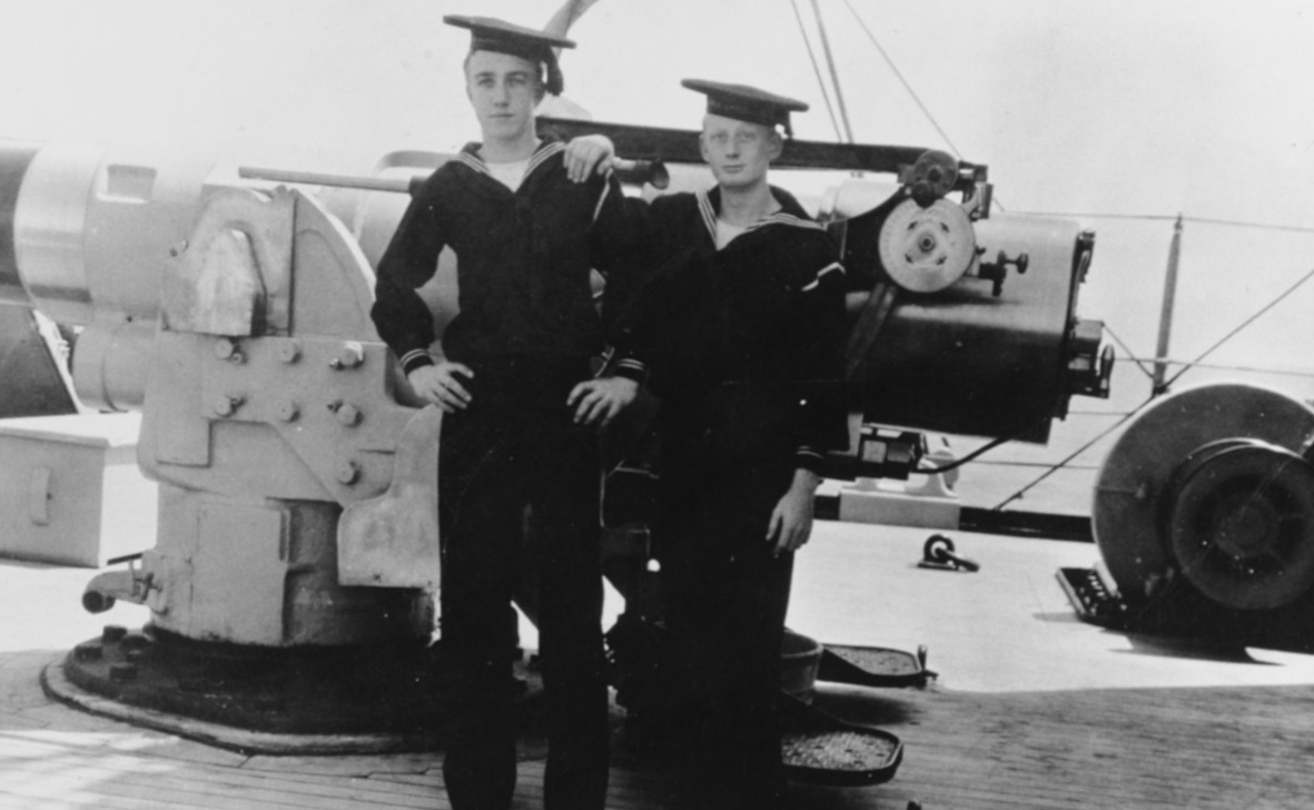 Ordinary Seamen J.A. York (left) and James B. Dofflemeyer of the ship's company stand by her forecastle 6-inch gun, 9 May 1909. (Naval History and Heritage Command Photograph NH 83105)