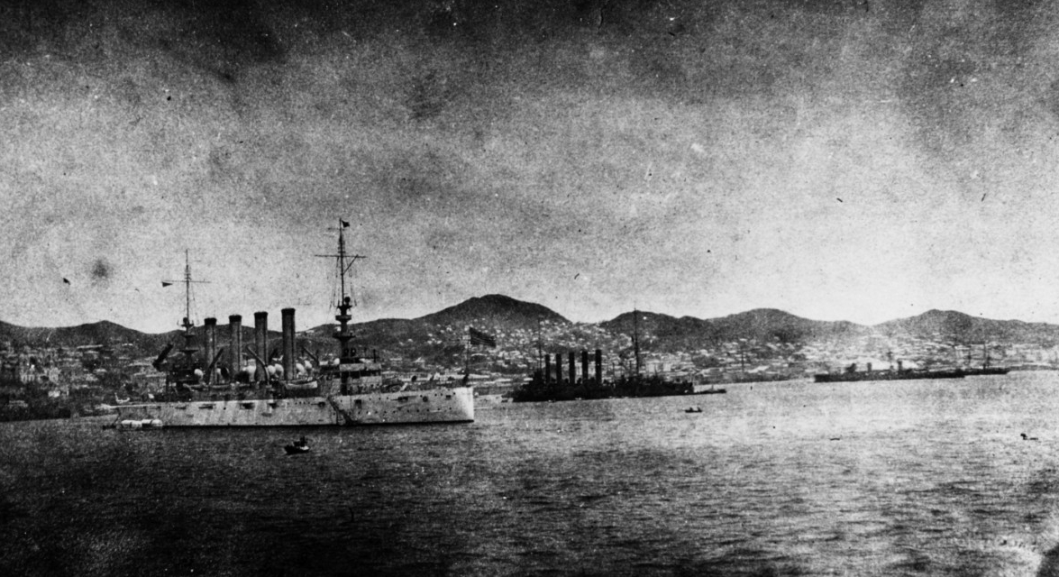 Charleston drops anchor near (left–right) Russian protected cruisers Askold and Zhemchug during her visit to Vladivostok, Russia, 22–26 June 1909. The officers and men of the three ships amicably exchanged greetings, but German light cruiser Emden would sink Zhemchug at George Town [Penang, Malaysia] on 28 October 1914, and in 1918 the British would seize Askold and rename her Glory IV, though she would later be scrapped. (Naval History and Heritage Command Photograph NH 88555)