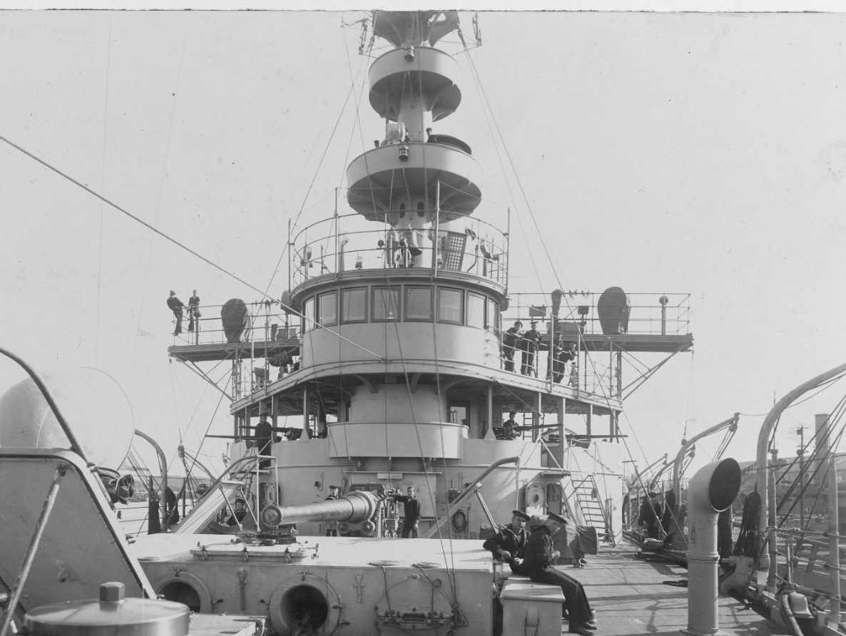 Another early glimpse of the ship, this time the forecastle looking aft, 17 November 1905. Note the bridge details, ventilators, winch cover, and the 6-inch gun. (Naval History and Heritage Command Photograph NH 78682)