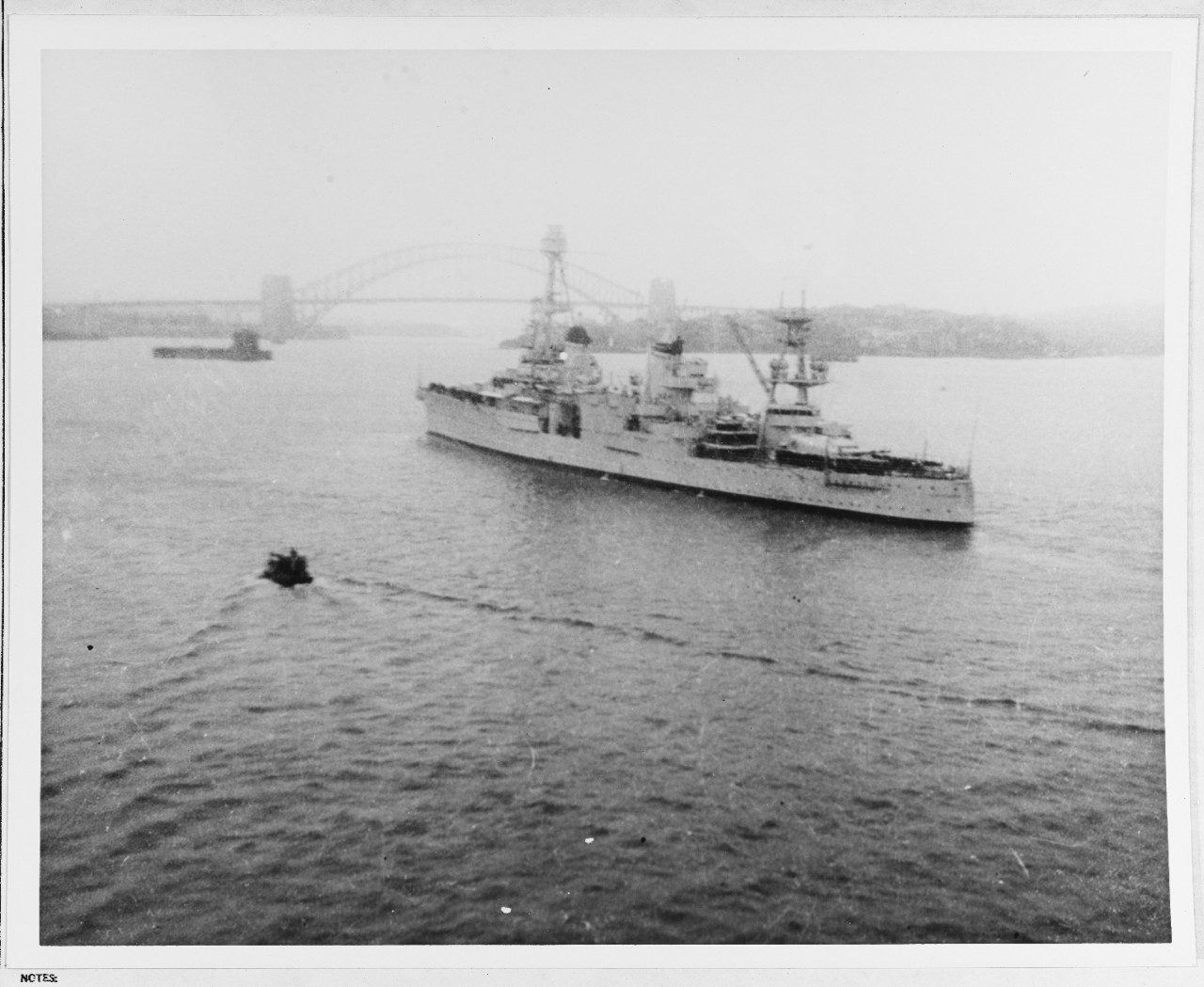 Famed Sydney Harbour Bridge looms through the haze as Chicago enters Sydney, Australia, 20 March 1941. (Naval History and Heritage Command Photograph NH 66291)