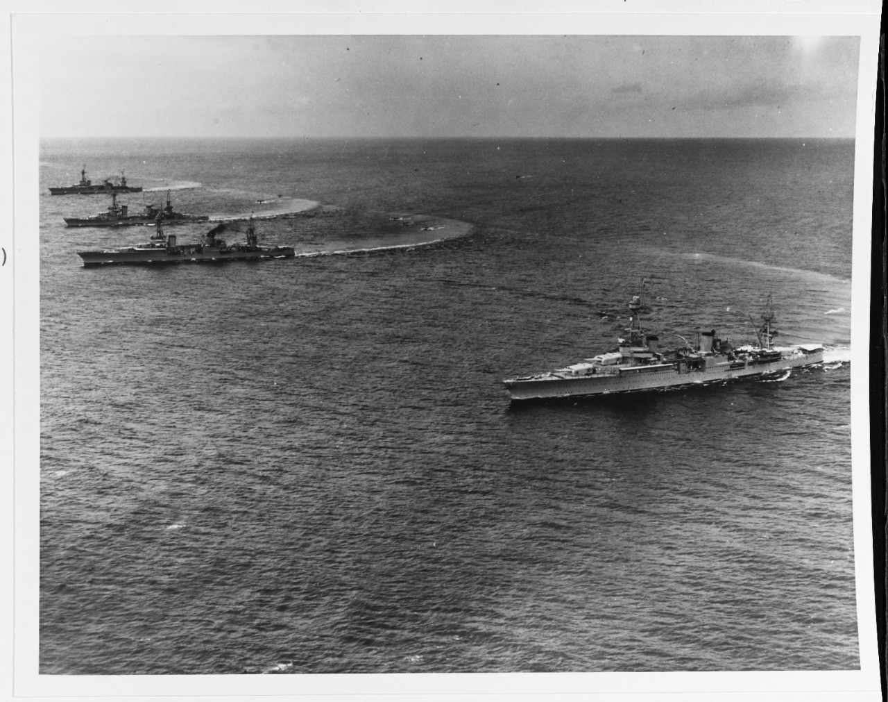 Chicago (right) demonstrates her nimble turning abilities as Scouting Force heavy cruisers turn to create a slick for floatplanes to land during maneuvers in Hawaiian waters, 31 January 1933. The other cruisers are (front to back) Louisville (CA-28), Salt Lake City (CA-25), and Northampton (CA-26). (U.S. Navy Photograph 80-G-451165, National Archives and Records Administration, Still Pictures Branch, College Park, Md.)