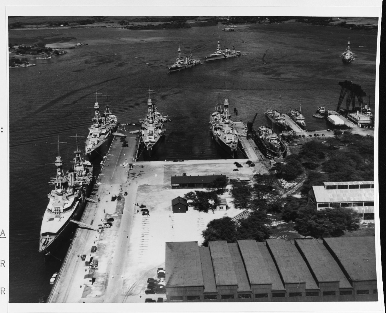 Scouting Force ships at, and off, Pearl Harbor Navy Yard, T.H., 2 February 1933. The heavy cruisers tied up at 1010 Dock are (from left to left center) Augusta (CA-31), Chicago (CA-29) and Chester (CA-27). Northampton lies alongside the dock in the center, with Kane (DD-235) in the adjacent Marine Railway and Fox (DD-234) berthed nearby. Louisville is in the center distance. Moored off her bow and at the extreme right are Salt Lake City and Pensacola (CA-24). (U.S. Navy Photograph 80-G-451164, National Archives and Records Administration, Still Pictures Branch, College Park, Md.)
