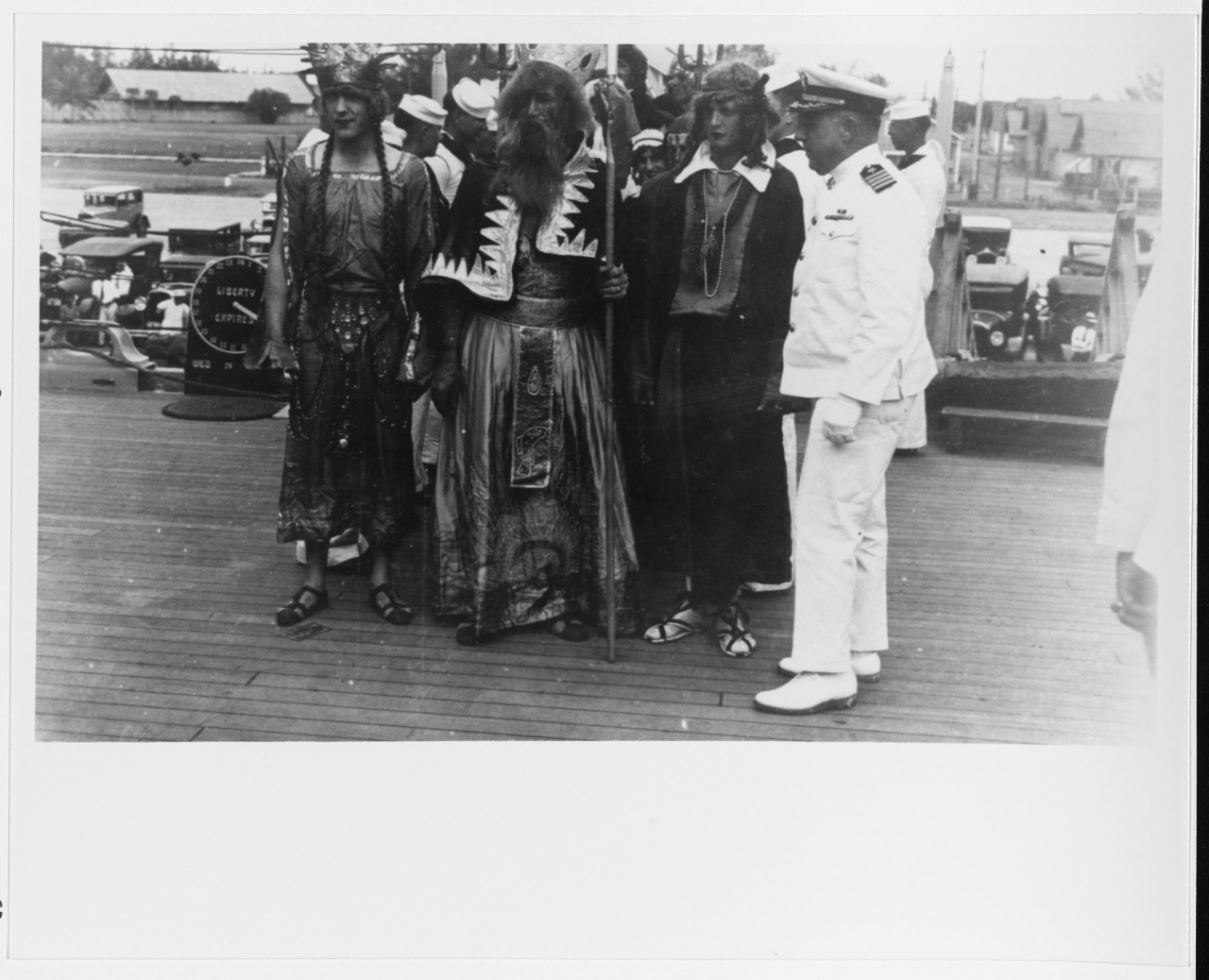 Capt. Manley H. Simons, Chicago's commanding officer, welcomes King Neptune and his court on board the cruiser while she crosses the equator, not far from Pago Pago, 1931. Note the liberty clock in the background. (Courtesy of Wiley H. Smith, Naval History and Heritage Command Photograph NH 93456)